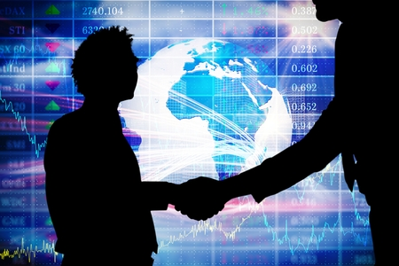 financial figure: composite of business people shaking hands with stock background