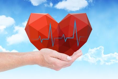 digital composite: Digital composite of hand holding a heart