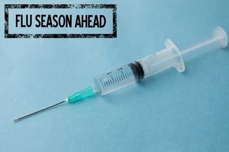 surgical needle: Composite image of fight the flu with syringe background