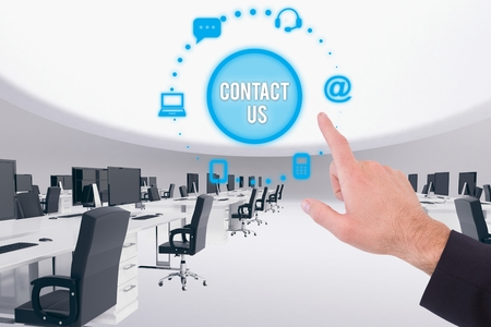 swivel chairs: Digital composite of Hand pointing to contact us Stock Photo