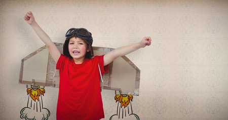 arma: Boy pretending to be a pilot against room with wooden floor Stock Photo