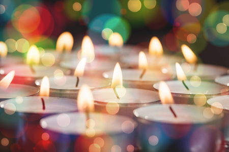 burning time: Close-up of candles burning bright during christmas time