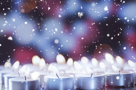burning time: Candles burning bright during christmas time Stock Photo