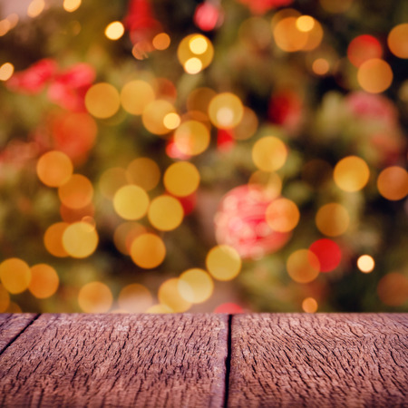 christmas grounds: Wooden floor  against desk with christmas tree in background