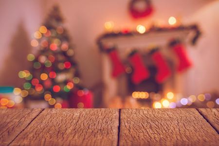 copyspace: Wooden floor  against defocused of christmas tree lights and fireplace