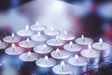 burning time: Burning candles on table during Christmas time Stock Photo