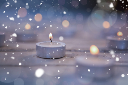 burning time: Candles burning on wooden plank during christmas time Stock Photo