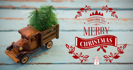 tempo: Christmas greeting  against toy tempo carrying christmas fir on wooden plank