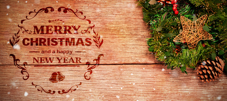 Christmas greeting  against wreath with christmas decoration Stock Photo