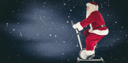 home trainer: Santa uses a home trainer against blue sky with clouds