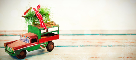 tempo: Toy tempo carrying christmas fir on wooden plank during christmas time