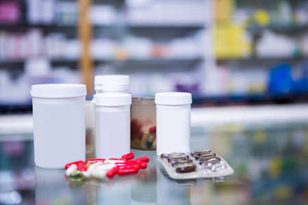 Close-up of various prescription medicines on table in pharmacy
