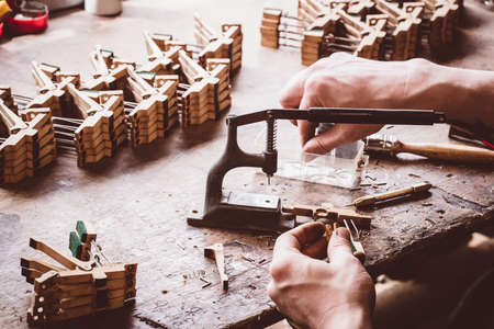 classical mechanics: Piano technician working on piano parts at workshop LANG_EVOIMAGES