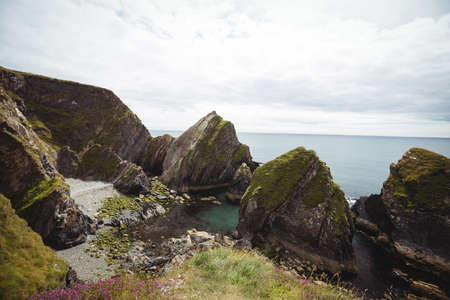 rock formation: View of beautiful rock formation and sea LANG_EVOIMAGES