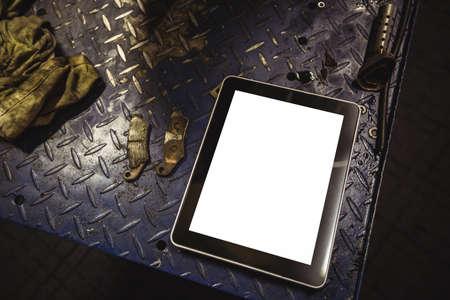 wireless tool: Digital tablet on workbench at workshop LANG_EVOIMAGES