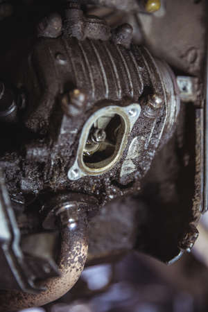 Close-up of motorbike engine in workshop