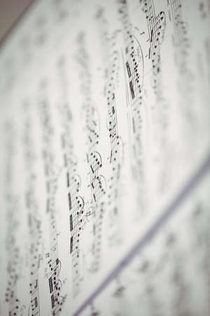 transcription: Close-up of music sheet in music school