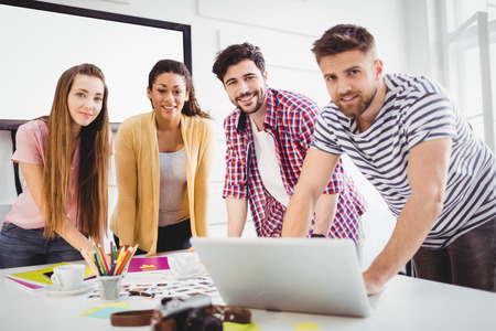 editors: Portrait of happy young editors at creative office Stock Photo