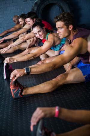 healthy men: Young athletes stretching in gym Stock Photo
