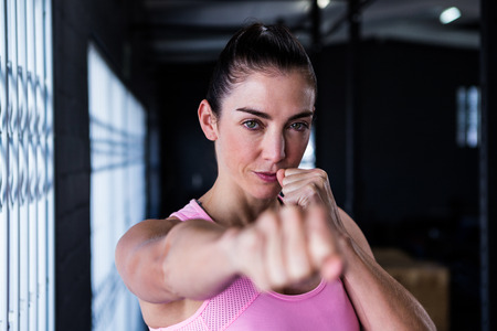 punched out: Portrait of confident athlete punching in gym