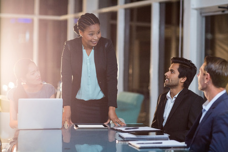 Businesswoman interacting with coworkers in a meeting in the conference room Stock Photo - 64372557
