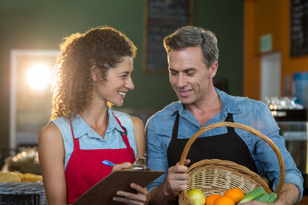 Staff members maintain records on clipboard Stock Photo