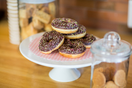 Doughnuts on cake stand in café Stock Photo