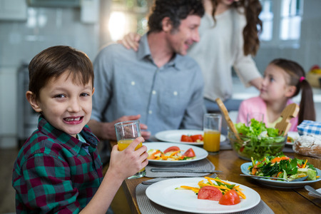 Happy family having breakfast in kitchen Stock Photo