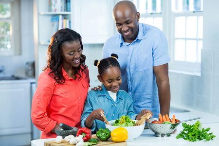 classy house: Happy family preparing food in kitchen