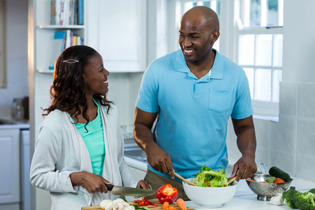 classy house: Couple preparing food in kitchen