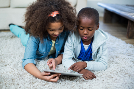 classy house: Children using digital tablet at home