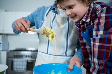Father and son preparing cupcake in the kitchen Stock Photo