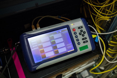 analyzer: Close-up of digital cable analyzer in server room Stock Photo