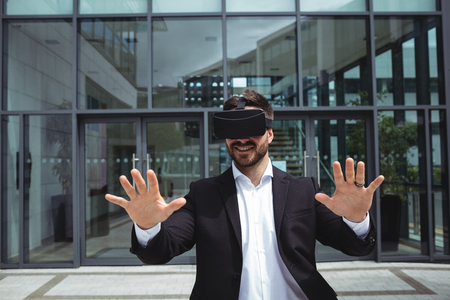 virtual office: Businessman using reality virtual headset in office building