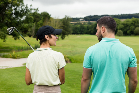 computer club: Couple interacting with each other on a golf course