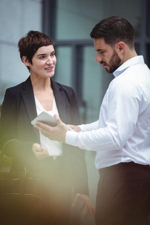 premises: Businesspeople using digital tablet in office premises