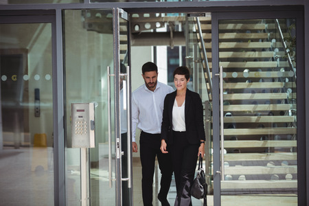 company premises: Businesspeople interacting with each other while leaving office