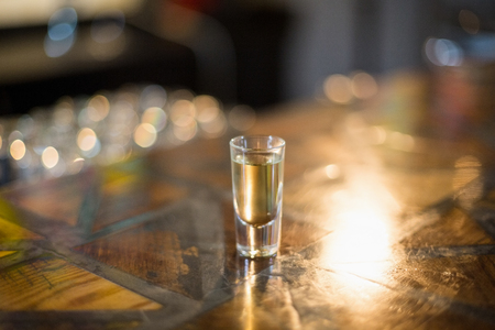 shot glass: Tequila shot glass on counter at bar