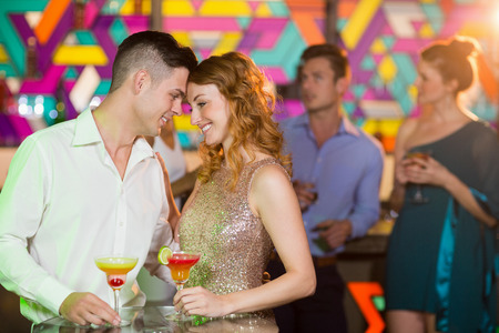 affections: Happy romantic couple having glass of cocktail in bar