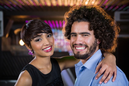 dance bar: Portrait of romantic couple dancing together on dance floor in bar