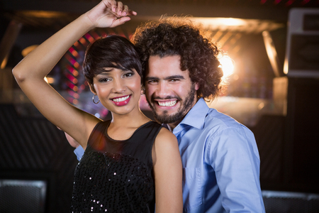 dance bar: Portrait of cute couple dancing together on dance floor in bar