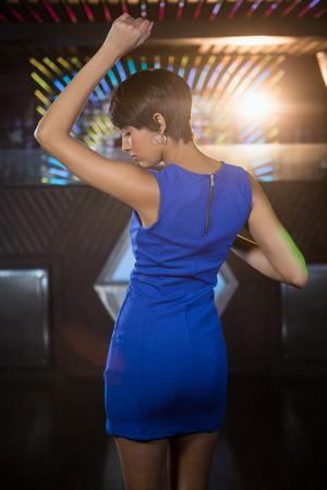 dance floor: Young woman dancing on dance floor in bar