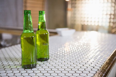 Bottle of beer on bar counter in bar Stock Photo
