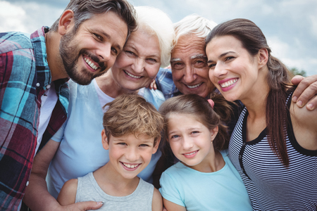 multigeneration: Portrait of happy multi-generation family standing  outdoors Stock Photo
