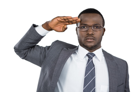 saluting: Close-up of businessman saluting against white background
