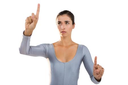 gesturing: Confident woman gesturing against white background