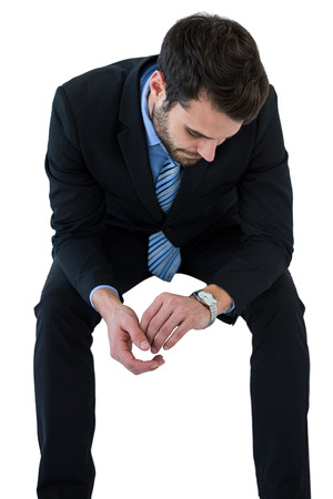 checking time: Businessman checking time on white background
