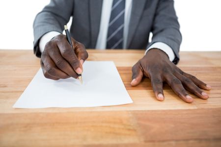 domestic policy: Close-up of businessman writing on a paper