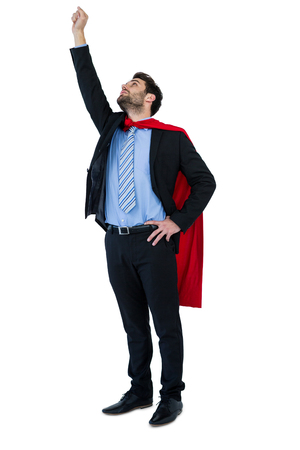 Businessman pretending to be a super hero on white background