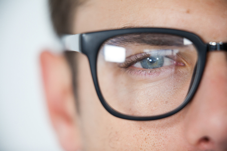 wearing spectacles: Close-up of man wearing spectacles